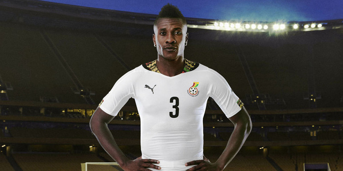 Asamoah Gyan in the Puma  jersey used for the 2014 World Cup.