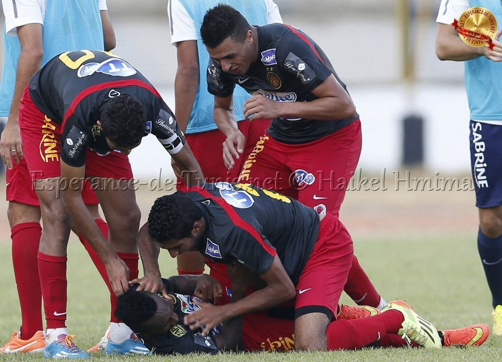 Harisson Afful mobbed by his teammates.