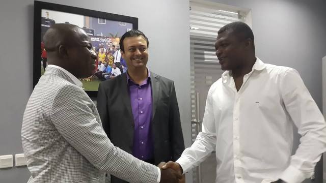 Mahama Ayariga shaking hands with Marcel Desailly.