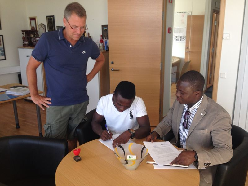 Augustine Okrah (signin) and his agent Oliver Arthur (right).