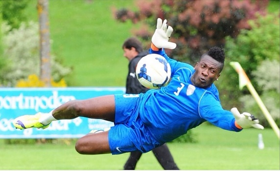 Striker Asamoah Gyan doing the business as a goalkeeper