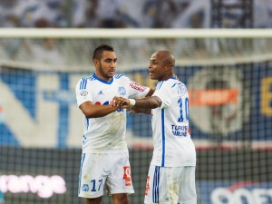 Marseille's French forward Dimitri Payet (L) celebrates with Marseille's Ghanaian forward Andre Ayew after scoring his second goal during the French L1 football match Olympique de Marseille vs OGC Nice on August 29, 2014 at the Velodrome stadium in Marseille, southern France. AFP PHOTO / BERTRAND LANGLOIS        (Photo credit should read BERTRAND LANGLOIS/AFP/Getty Images)