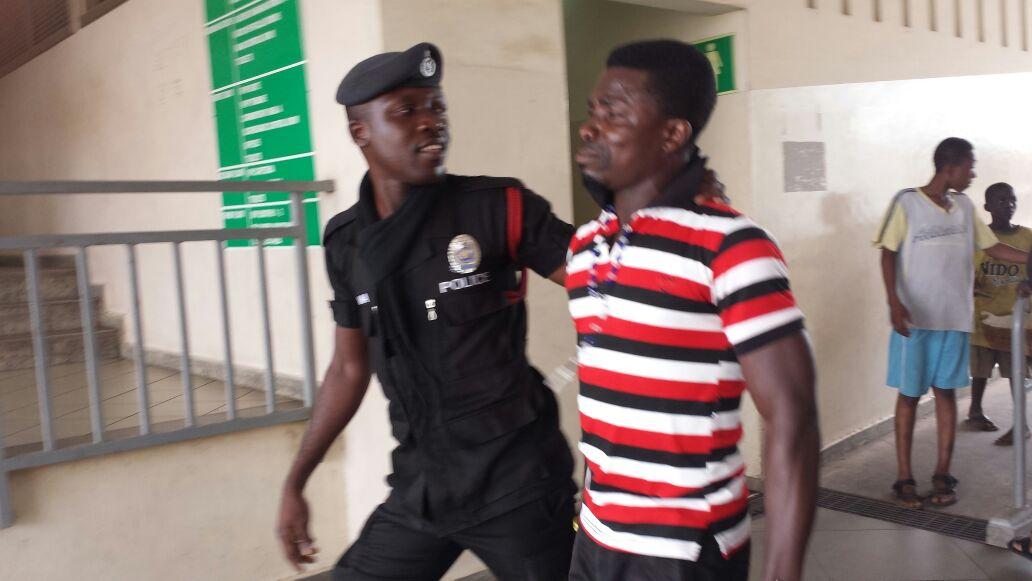 Police and fan in Kumasi