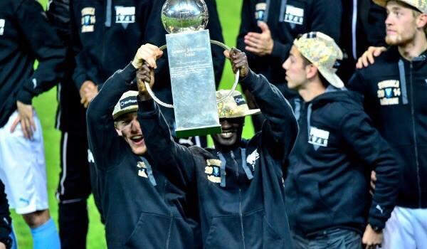 Adu lifts the trophy