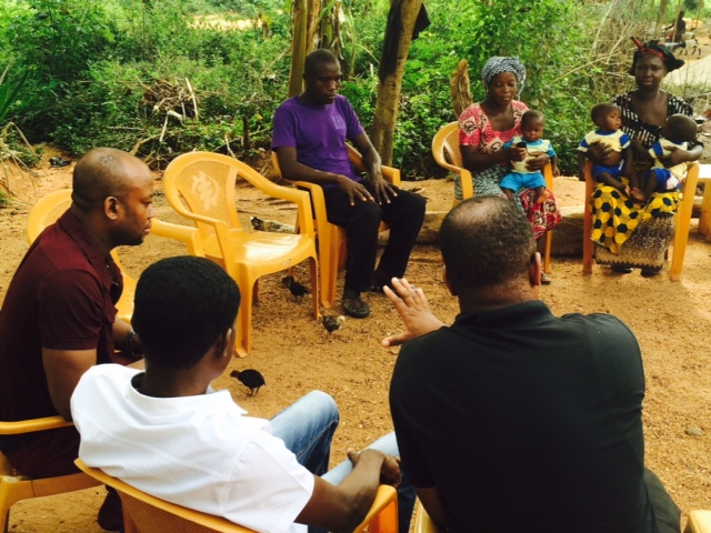 Chief Executive Officer of the Asamoah Gyan Foundation, Samuel Anim Addo meeting with the family of the triplets