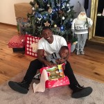 Kwadwo Asamoah wishes fans a 'Merry Christmas' from his Italy base with son
