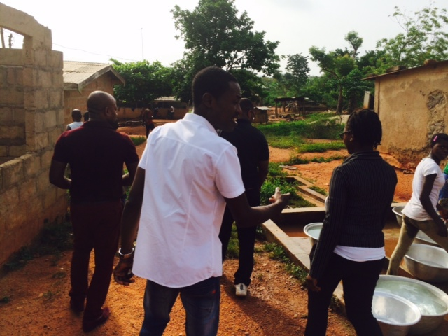 Officials of the Asamoah Gyan Foundation making their way into the home of the triplets