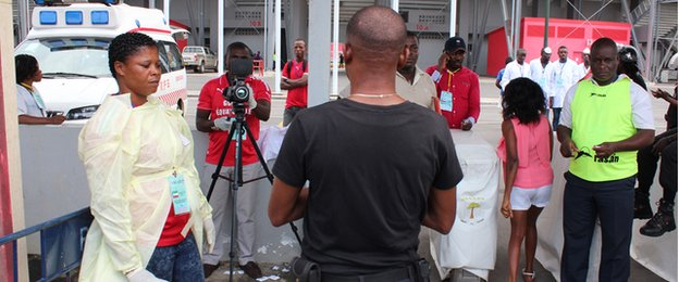 Fans being screened for Ebola at the Bata Stadium.
