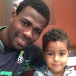 Razak Brimah spends quality time with his two-year-old son in Ghana camp