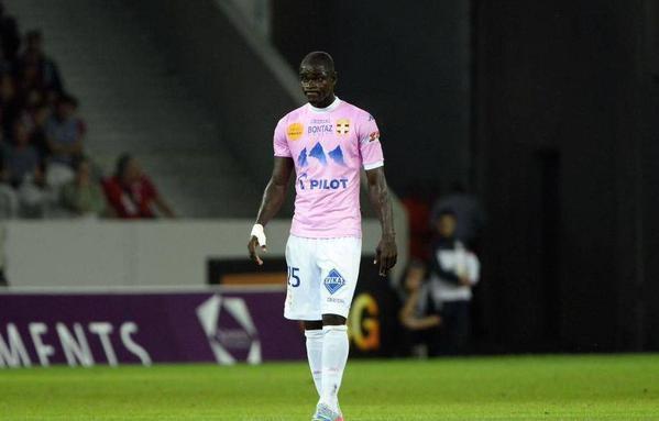 Jonathan Mensah watches his Evian TG side down Jordan Ayew's Lorient in France