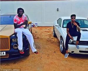 Emmanuel Adebayor flashes £250,000 Rolls Royce Ghost with Nigerian musician Whizkid