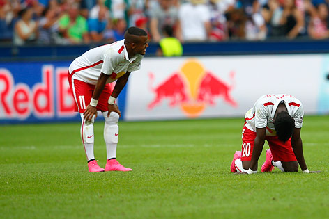 Atanga is dejected on his knees after game ended in a stalemate