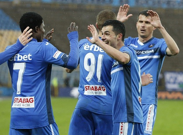 Francis Narh is congratulated by his team-mates for scoring