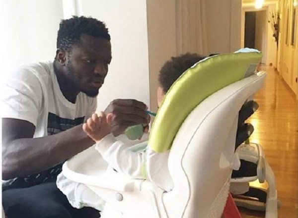 PHOTOS: Doting dad Sulley Muntari spoon-feeds son Jamal