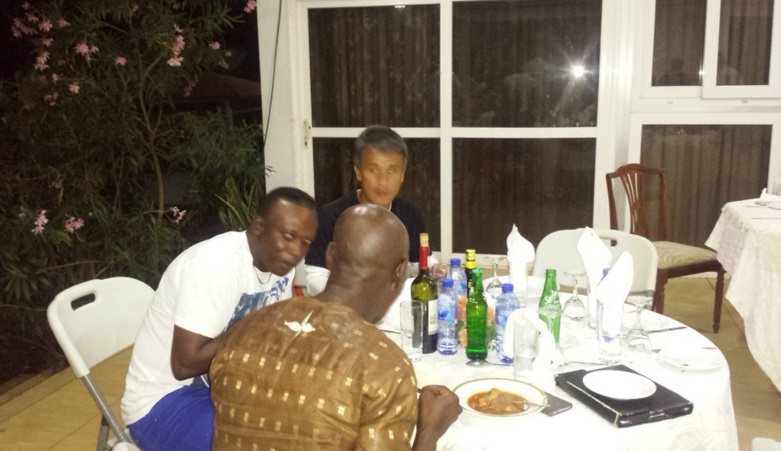 Hearts of Oak's head coach Kenichi and assistant Yaw Preko chat during the dinner