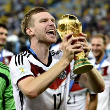 ARSENAL about to sign MERTESACKER on deal extension