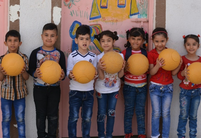 AFC seeding hope through football donation in Iraq