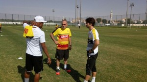 Gerard Nus (right) talking to Avram Grant and Andre Ayew.