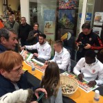 Ghanaian Alhassan Wakaso takes his turn to sign autographs for Lorient fans