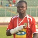 Injured Kotoko skipper Amos Frimpong in a haste to join team mates on the field