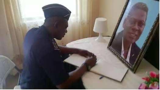 IGP David Asante-Apeatu signs Sam Arday's book of condolence