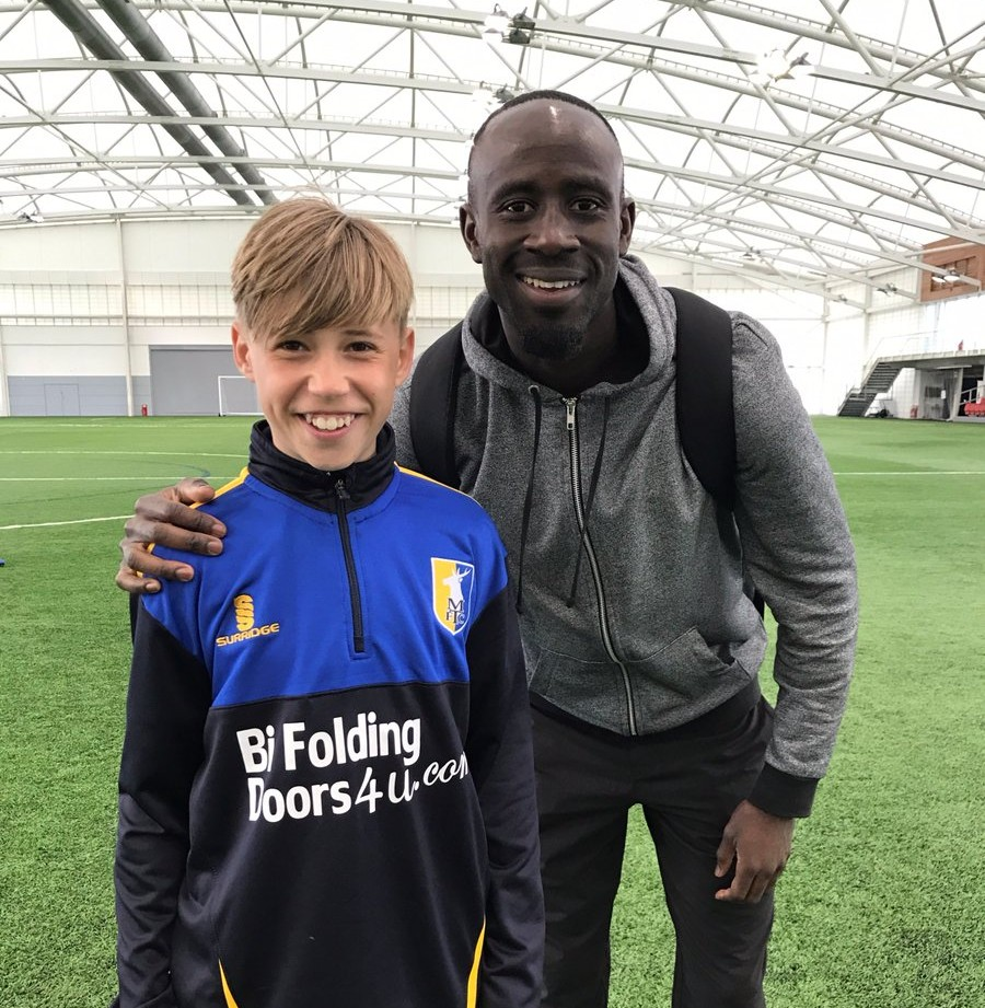 KIND GESTURE: Aston Villa's Albert Adomah trains young players of Mansfield Town
