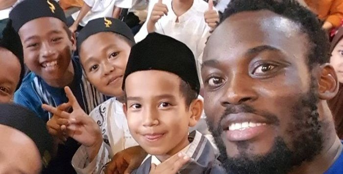 Michael Essien joins Muslim children in breaking Ramadan fast in Indonesia