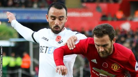 Leon Britton: Swansea midfielder could miss Manchester United match
