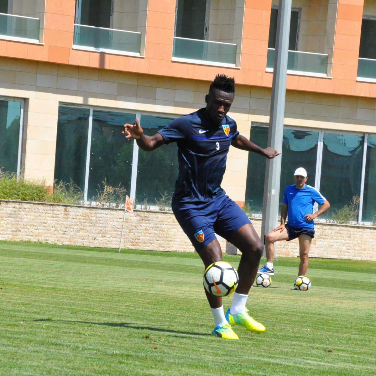 Asamoah Gyan returns to first team training after recovering from back problem