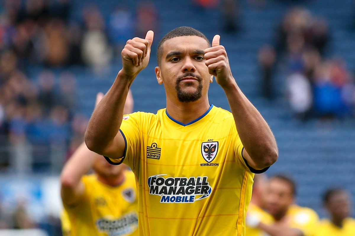 Kwesi Appiah picks  up scary looking injury in FC Wimbledon's defeat to MK Dons