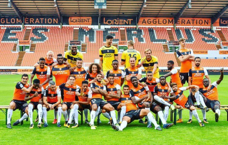 Majeed Waris shows up for Lorient's team photo shoot looking like he would rather be elsewhere