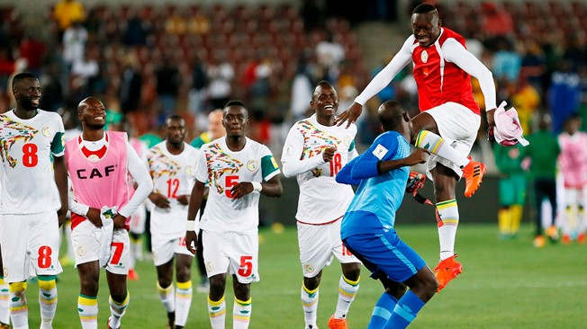 Senegal soar as top five hold firm