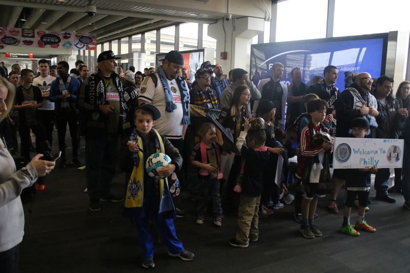 PHOTOS: Union supporters welcome David Accam, confused air travelers to Philadelphia