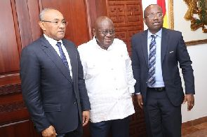 President Akufo-Addo poses with CAF and GFA presidents Mr Ahmad and Mr Nyantakyi respectively