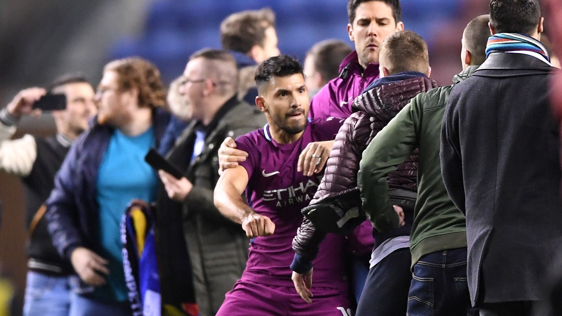 Aguero appears to clash with fan on pitch
