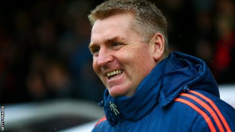 Dean Smith: Brentford head coach and assistants extend deals
