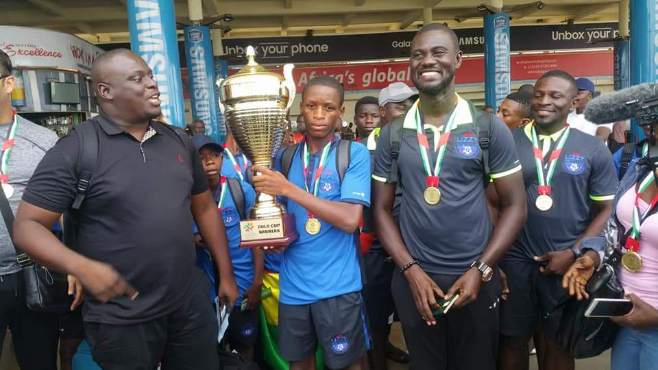 VIDEO: Joyous Lizzy Sports Complex U13 coach Nana Agyemang lead side to sing on arrival from Dubai