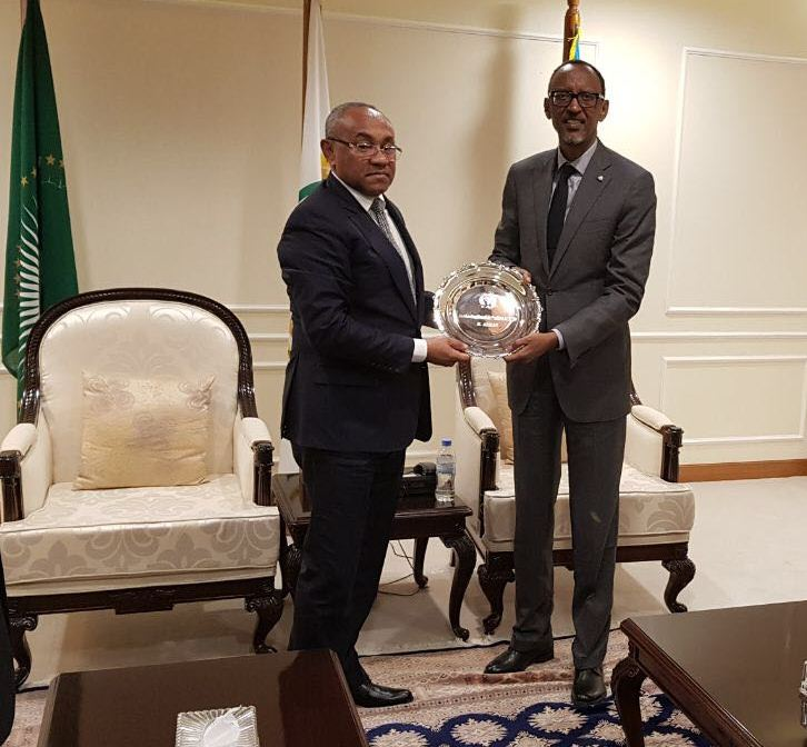 President Paul Kagame receives a present from CAF boss Ahmad on Monday.