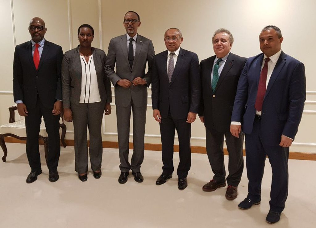 President Paul Kagame takes a photo wit CAF Delegaton alongside Sports Minister Uwacu Juliene and FERWAFA president Nzamwita Vincent