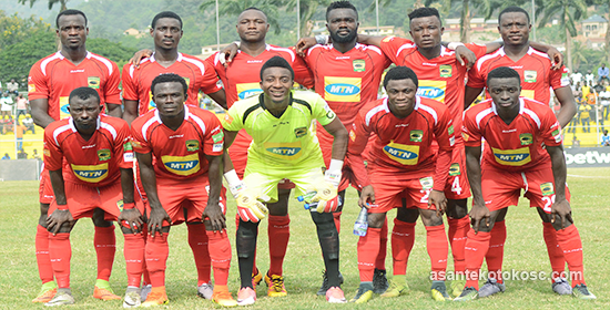 Asante Kotoko goalkeeper Felix Annan congratulates team-mates after Sharks win