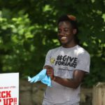 Ghanaian forward Edward Opoku volunteers for Keep Columbus Beautiful clean up exercise