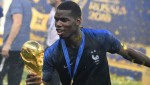 PHOTO: Man Utd Star Paul Pogba Dabs With World Cup Trophy as He Silences His Critics