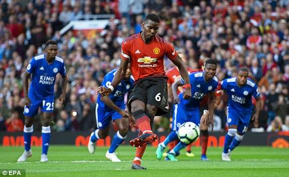 Daniel Amartey watches as Pogba converts the first goal of the season