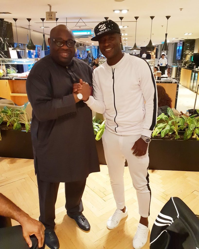 PHOTOS: Ghana captain Asamoah Gyan meets Nigerian politician Dele Momodou and Nollywood star RMD at Istanbul airport