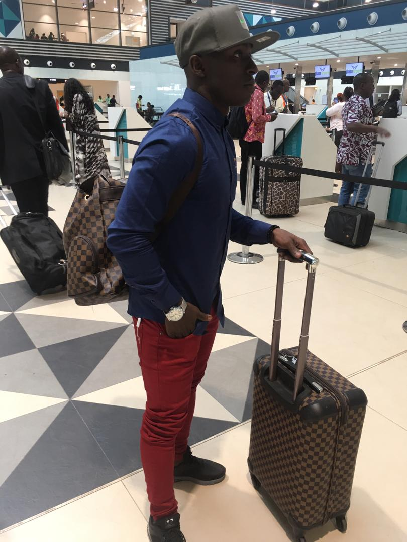 PHOTOS: Patrick Razak arrives in Conakry to sign two-year Horoya contract