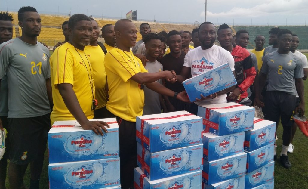 Paradise Pac donates bottled water to Black Stars in camp