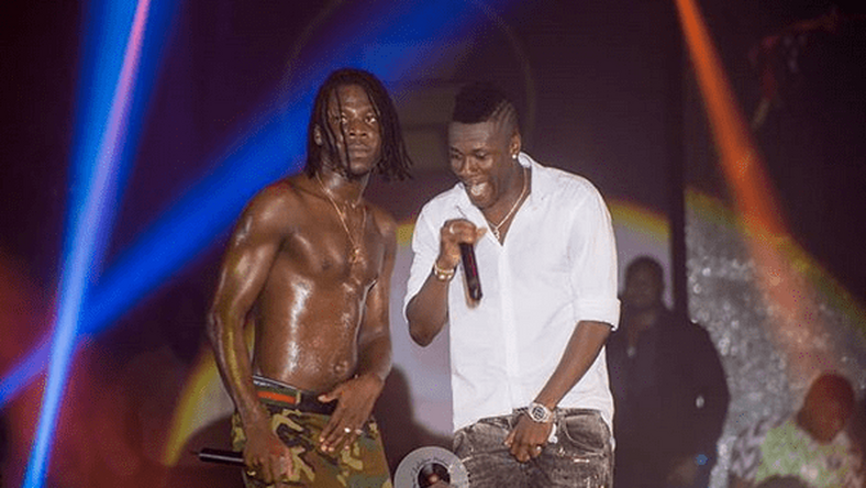 Video: Asamoah Gyan shrugs off 'broke' claims, delivers masterful concert performance with Adebayor
