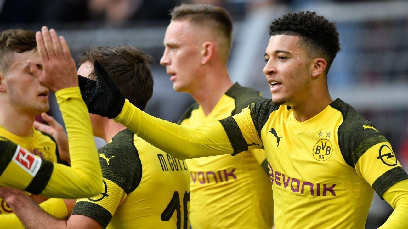 Sancho brace sends nervous Dortmund back on top