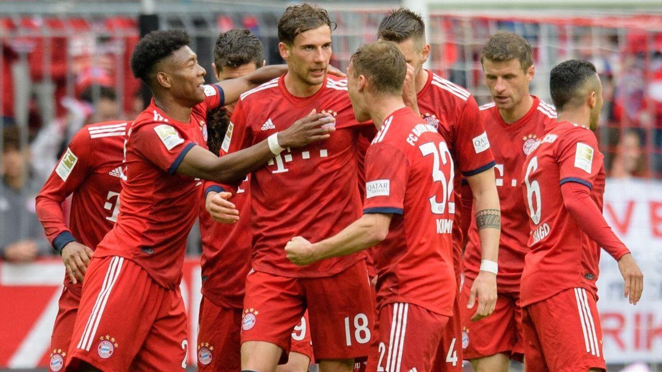 Bayern make hard work of table-propping 10-man Hanover 96