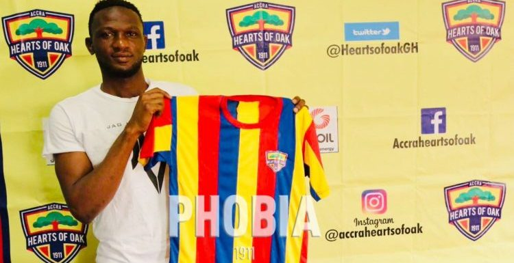 Hearts coach Kim Grant congratulates Mohammed Alhassan on his national team call-up